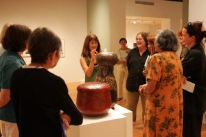 Docents in HiSAM gallery standing with artist Katheleen Kam