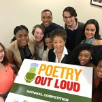 Group of Poetry Out Loud 2017 national finalists surrounding NEA Chairman Jane Chu, holding a sign for Poetry Out Loud