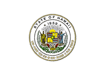 The circular seal for the State of Hawai'i. King Kamehameha is on the left with his right arms raised. Libery is on the right with her left arm raised while holding the Hawaiian flag in her right hand.
