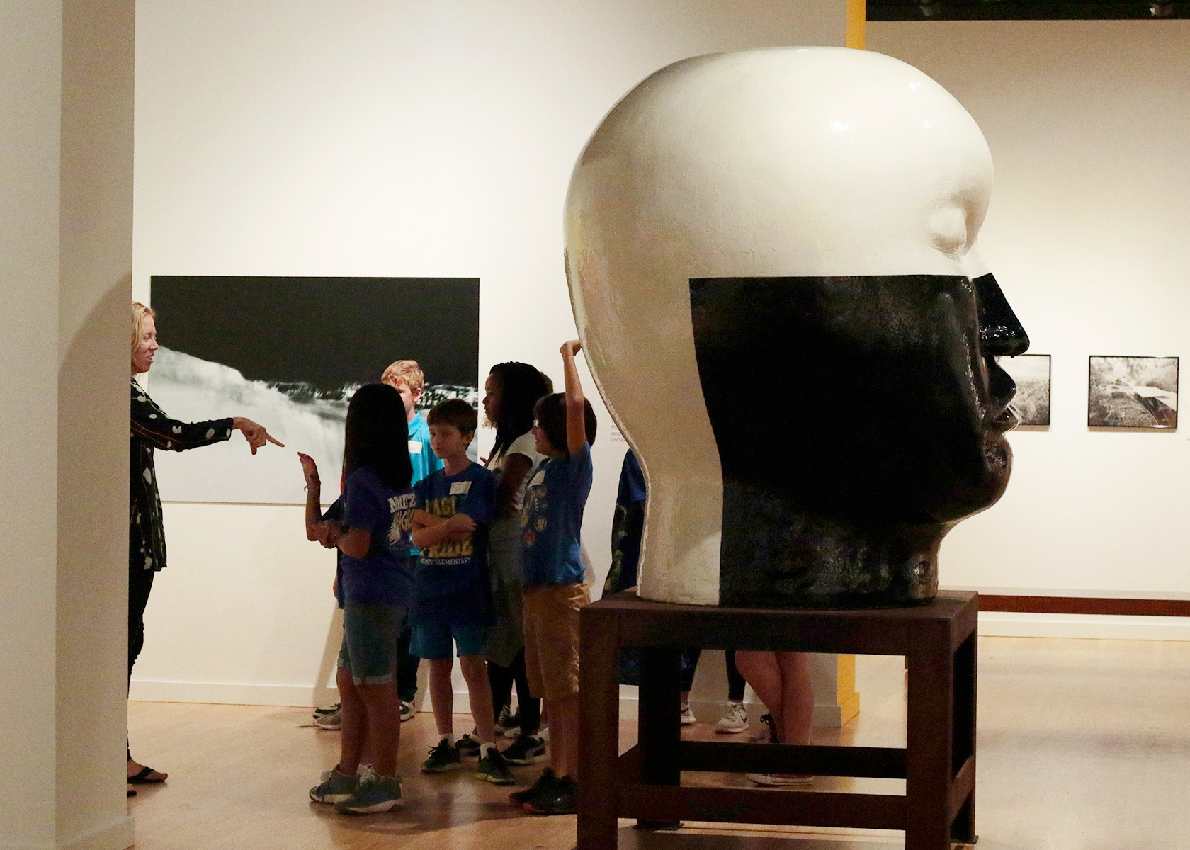 A group of grade school students in a museum gallery