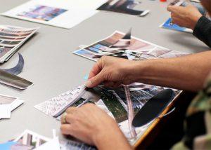 Hands arranging pieces of paper.