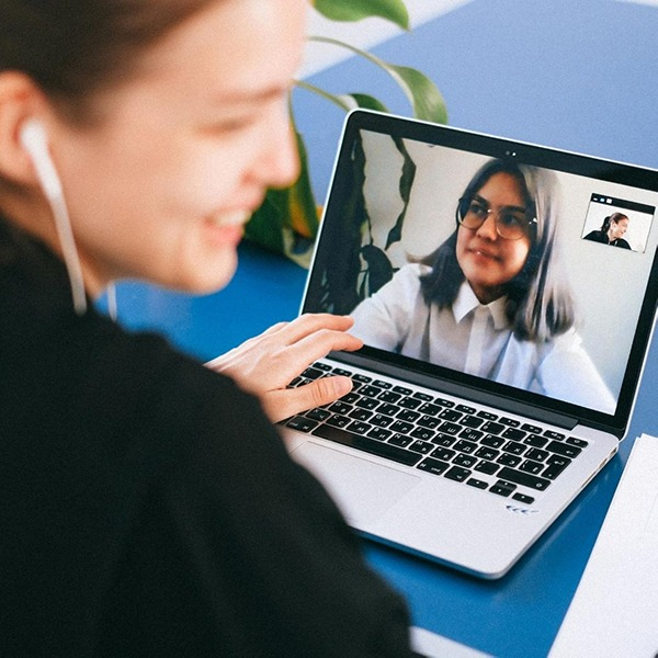 People in a video conference on a computer.