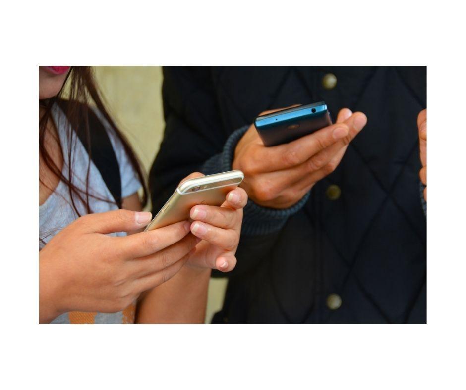 People looking at smartphones