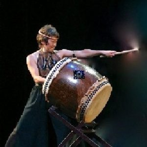 Chizuko Endo with a taiko drum and drumstick.