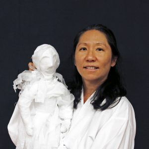 Bonnie Kim holding a puppet.