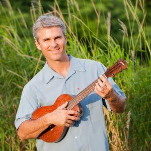 Jeremy Brown holding a ukulele